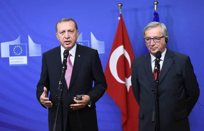 Turkey's President Recep Tayyip Erdogan (L) and European Commission President Jean-Claude Juncker address a brief statement as Erdogan arrive at the European Commission in Brussels, on October 5, 2015. AFP PHOTO / EMMANUEL DUNAND        (Photo credit should read EMMANUEL DUNAND/AFP/Getty Images)
