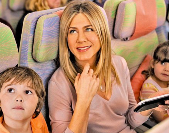 Jen makes friends in economy for new Emirates ad 28