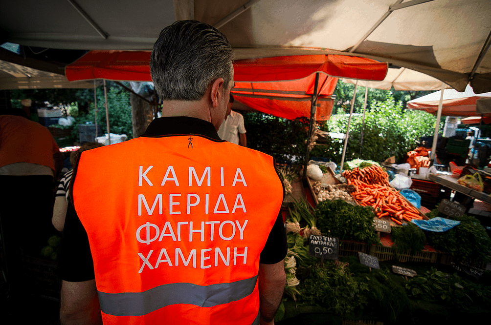 A Boroume volunteer at the Greek Farmers Market