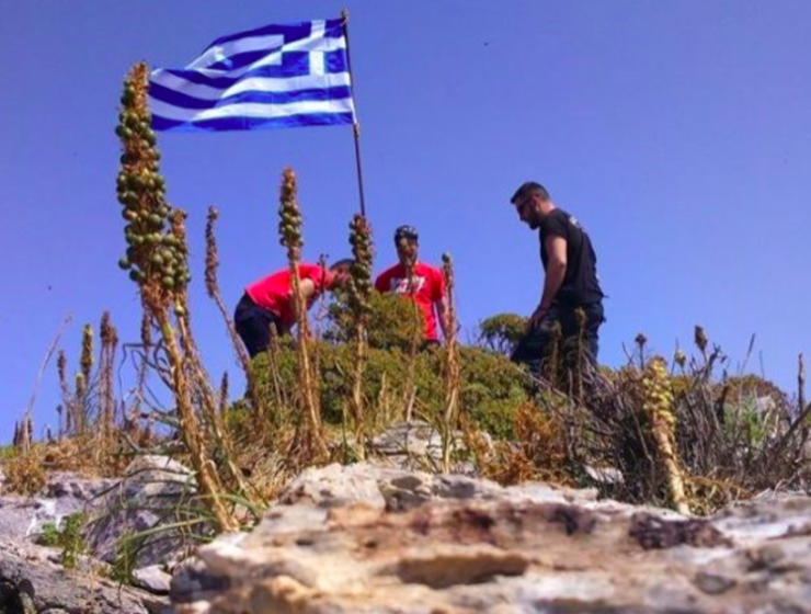 Three mates raise Greek flag on highest point of rocky island for Turkey to see 24