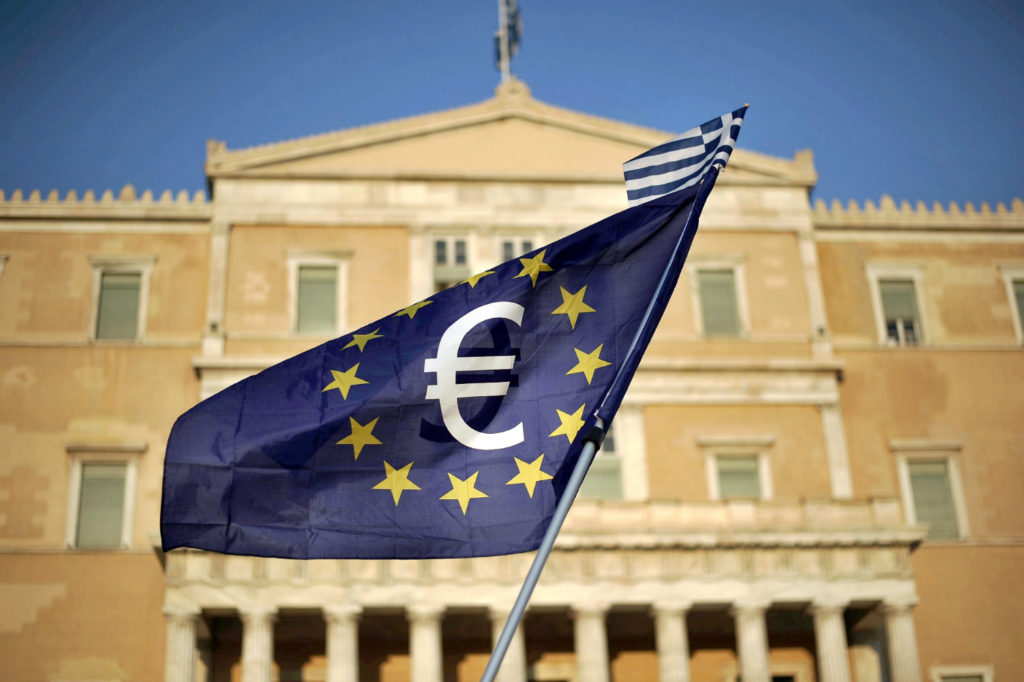 International Monetary Fund welcomes Greek debt deal but has reservations on long-term