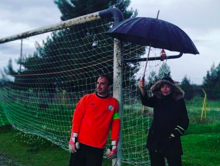 Photo of Greek Mum holding umbrella during her son's soccer game goes viral 9