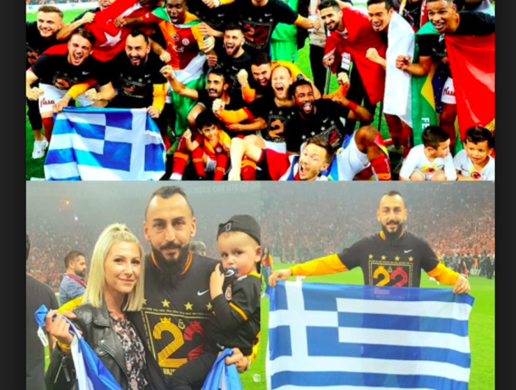 Greek striker Kostas Mitroglou celebrates championship win by holding up Greek flag in Turkish stadium   13