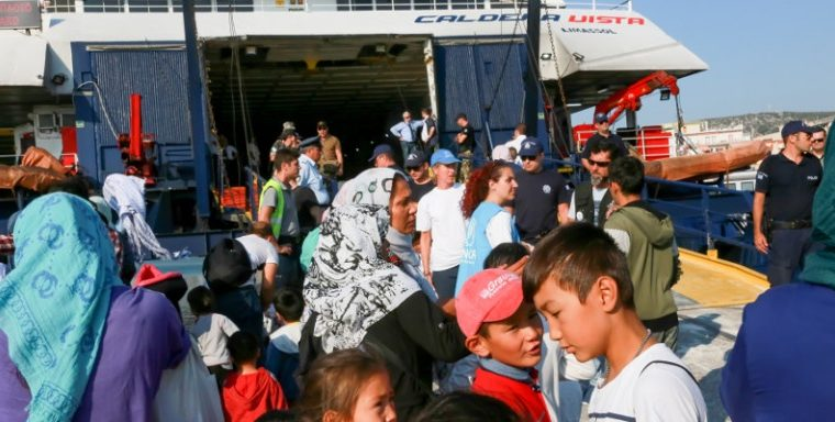 'Huge waves' of migrants continue arriving in Greece, causing chaos across the Aegean 27