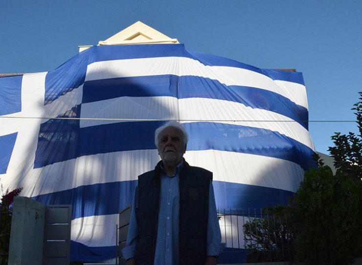Deputy Mayor proudly drapes entire home with giant Greek flag to celebrate 'Oxi Day' 1