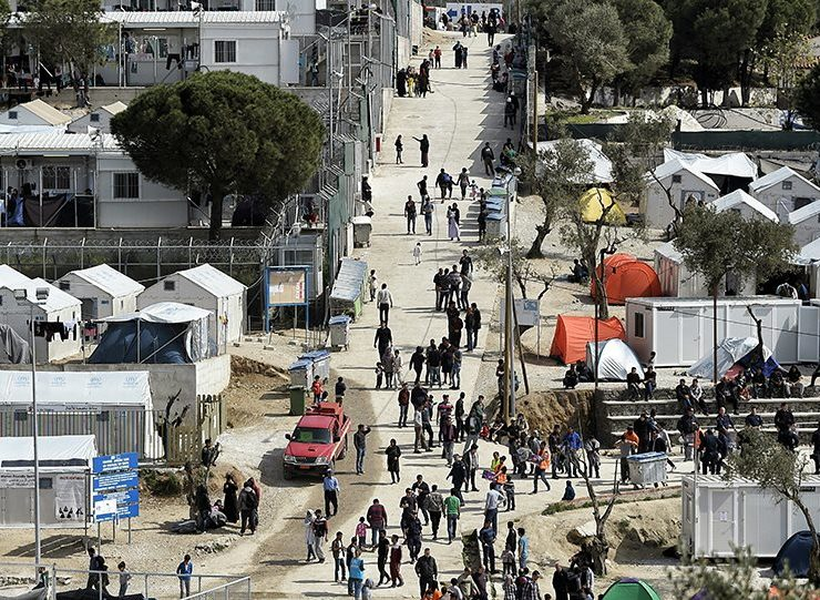 Greece to shut overcrowded migrant camps and replace with restricted facilities  14