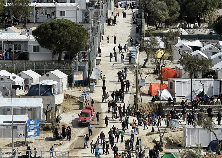 Greece to shut overcrowded migrant camps and replace with restricted facilities    12