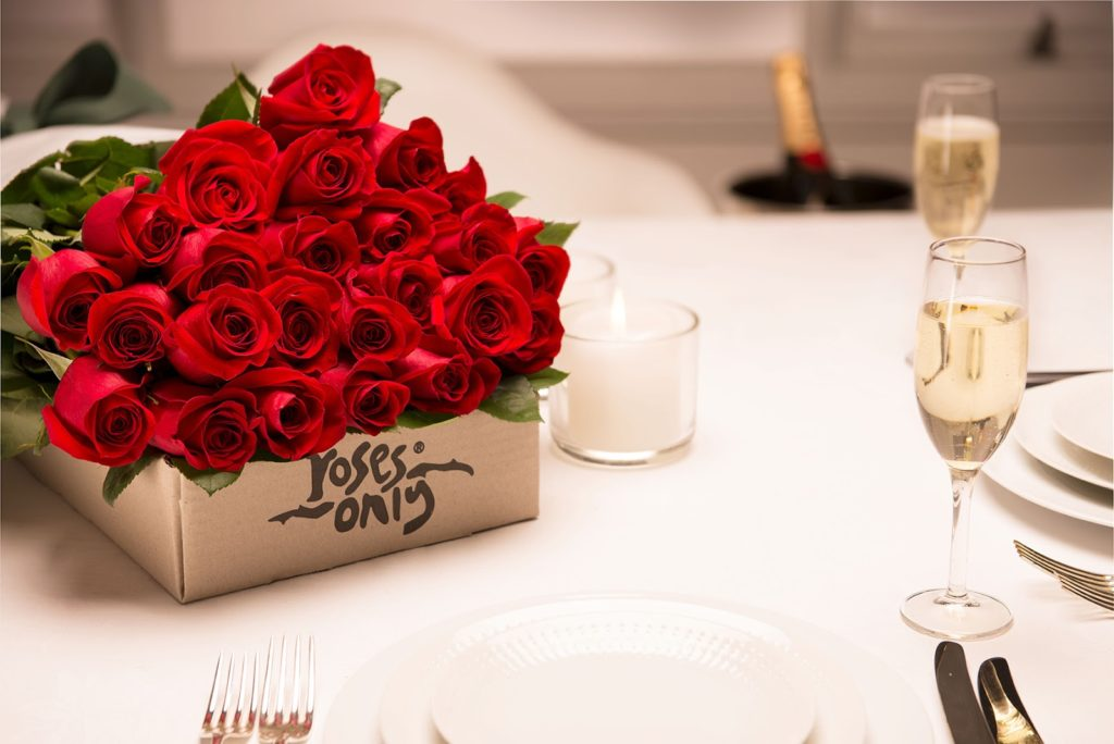 roses only red roses gift box and champagne