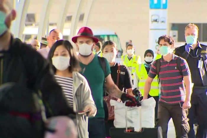 The first passenger to go into compulsory quarantine arrive at Sydney Airport