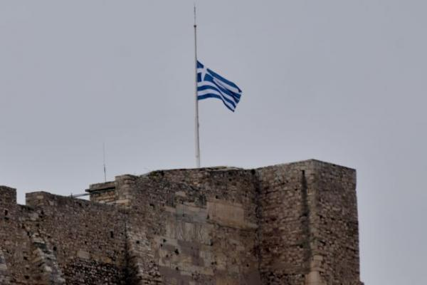 Acropolis flag at half mask