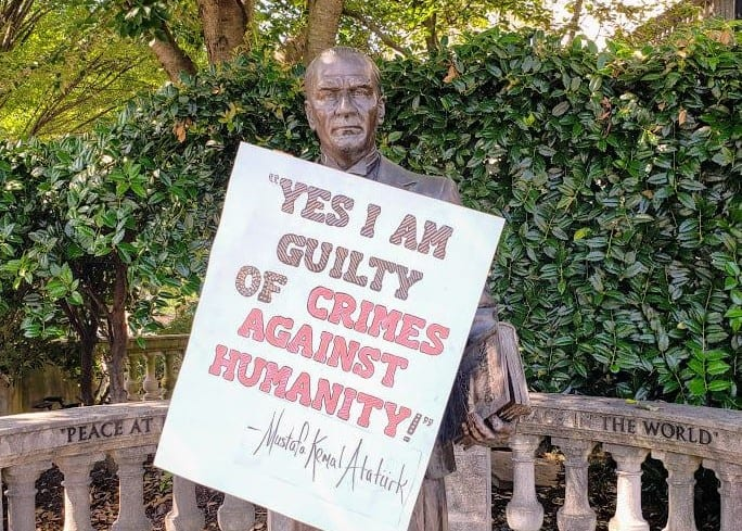 """Yes, I am guilty of crimes against humanity!"" appears on statue of Atatürk 1"