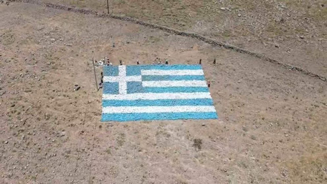 Agra, a village in Lesvos, create a Greek flag from stones