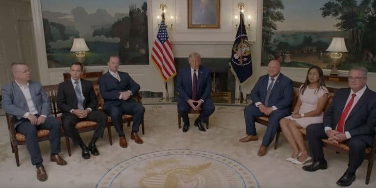 US President Donald Trump with Pastor Branson and other former hostages.