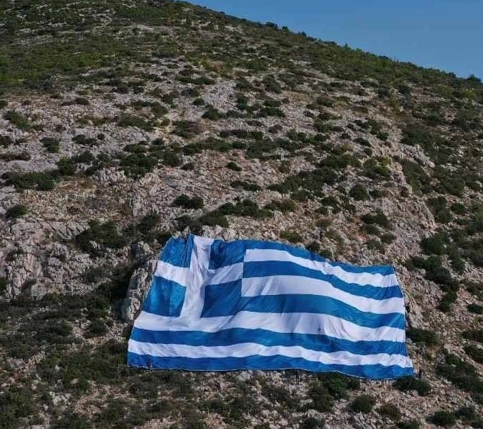 With pride,  up there on Mount Hymettus we put the Greek flag today!