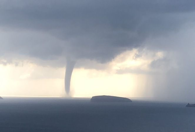 Impressive waterspout swirls near Santorini