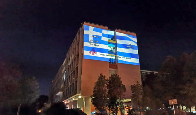"Huge Greek flag ""flies"" on a building in Kavala"