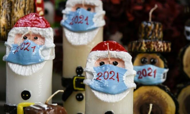 Greek candlemaker masks up Santa Claus and Snowman candles