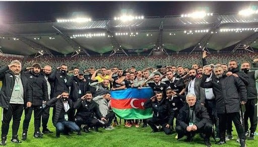 Qarabağ performing a military salute during their Europa League qualifying match away to Legia Warsaw on October 1. football