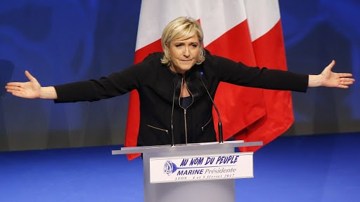 French Presidential candidate Marine Le Pen gestures as she speaks during a conference in Lyon, France, Sunday, Feb. 5, 2017.