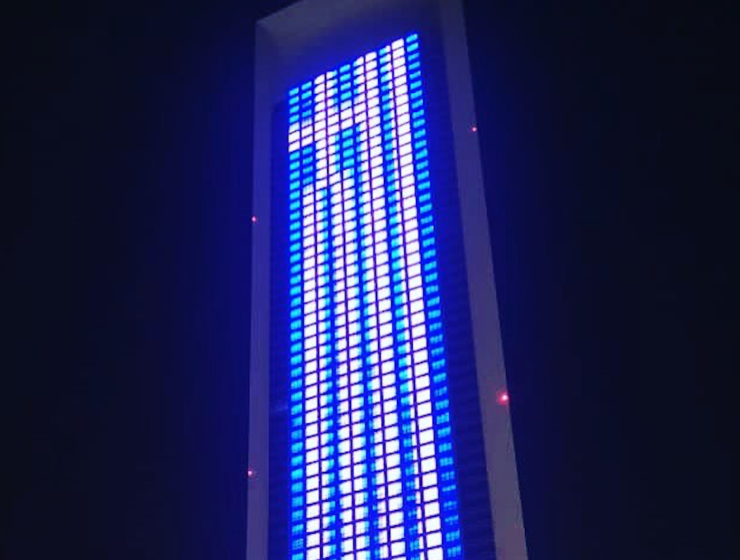 Abu Dhabi building lights up with Greek flag to welcome PM and delegation