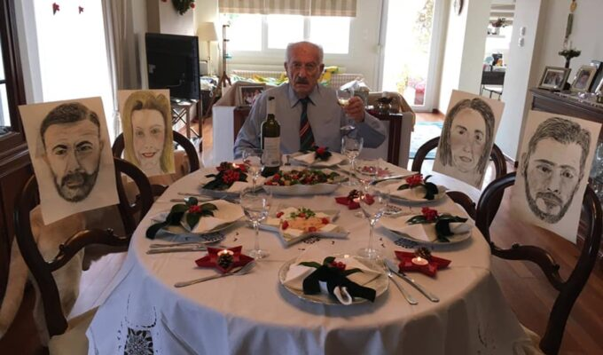 Greek parents fill empty seats at the Christmas table with portraits of their children