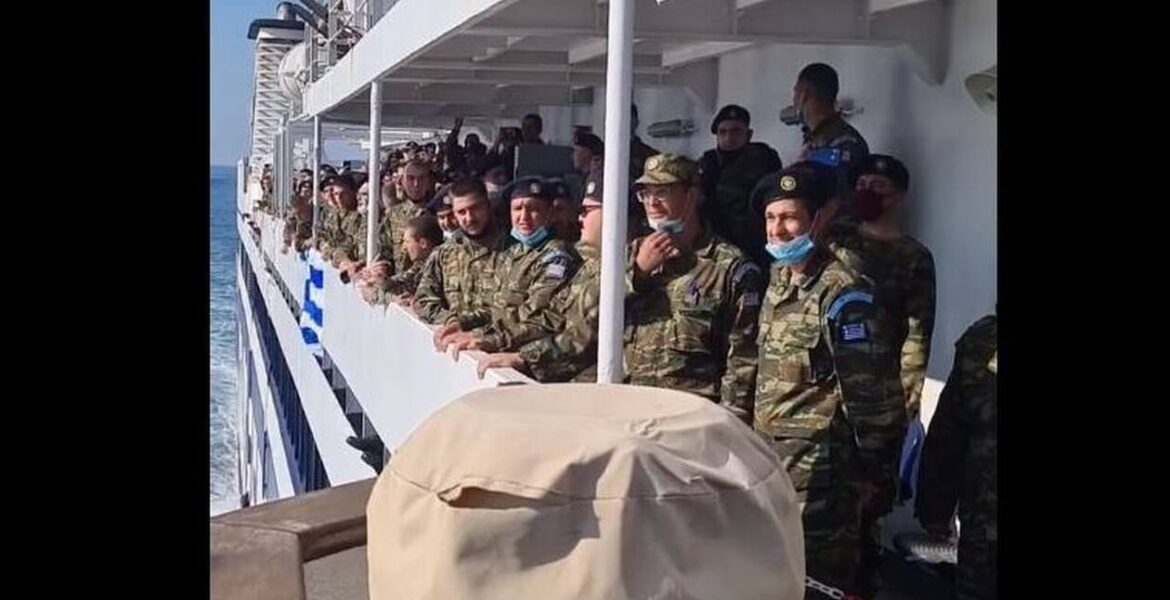 Footage of soldiers singing the Greek National Anthem as they approach Kastellorizo. (not Rhodes)