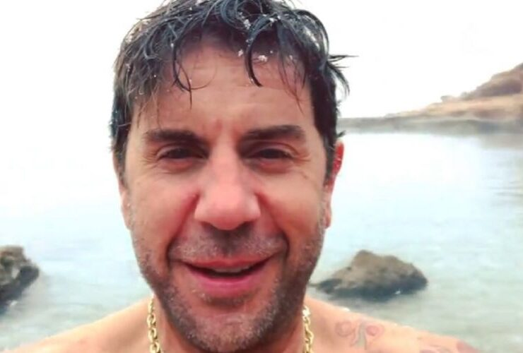 Giorgos Mazonakis goes swimming while it snows