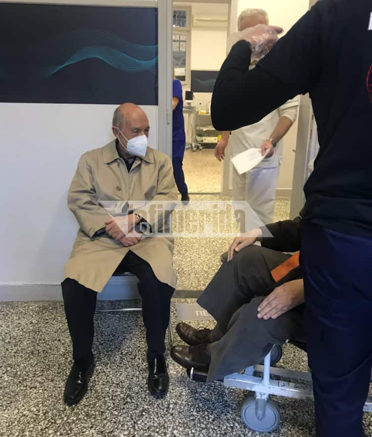 Former Greek PM Costas Simitis waits in line for Covid-19 vaccine