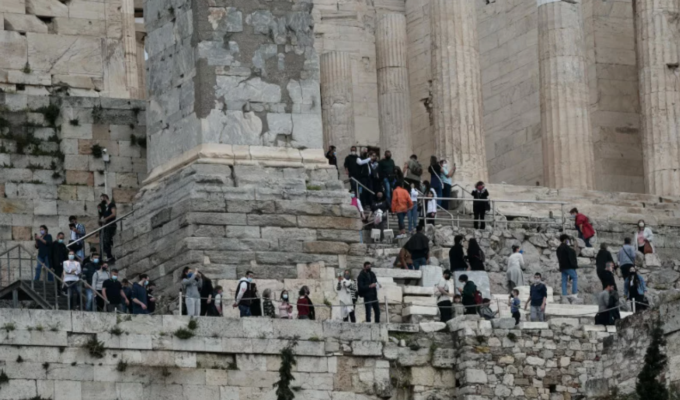 Visitors wait in long queues to visit the Acropolis on World Heritage Day
