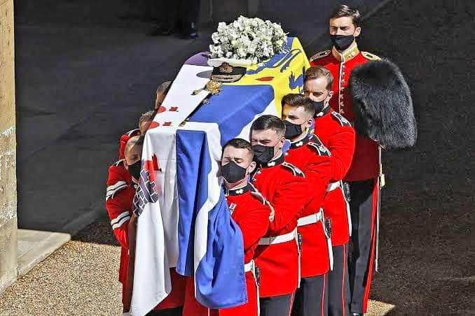 Prince Philip casket adorned with his personal flag, featuring the Greek national flag.