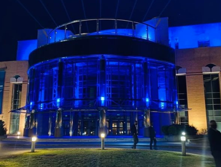 Thessaloniki Concert Hall lit up in colours of Greek flag