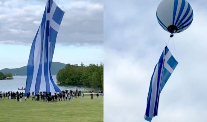 Largest Greek flag raised above Lake Plastira in Karditsa