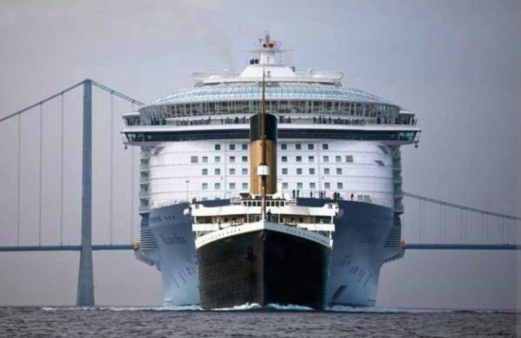 The Titanic in front of the 5 times larger Oasis of the Seas, currently the largest cruise ship in the world. Photo by Imgur.