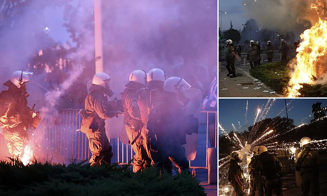 Greek riot police blast tear gas and water cannons in bid to stop 15,000 activists protesting mandatory vaccines from reaching area where PM was delivering an economic address 5